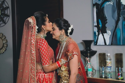 The bride kissing her mother's forehead