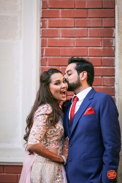 Candid capture of the bride and groom in contrast attires for the sangeet ceremony