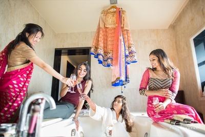 Bride having last minute bachelorette fun with her brides maids.