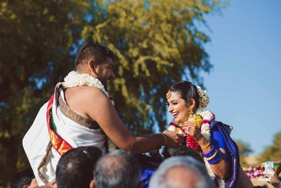 The bride and groom exchanging varmalas in a ceremony prior to the wedding.