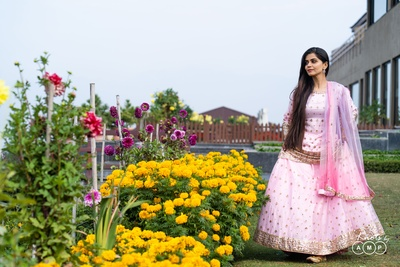 Ain looks gorgeous in a baby pink lehenga embellished with mirror work done by hand.
