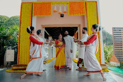 The couple being welcomed for their haldi ceremony in a traditional bengali way.