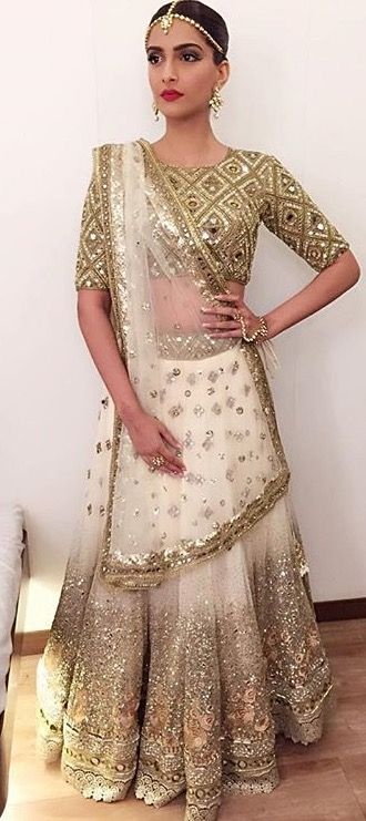 58dcbfde0ff0e1 This golden blouse design for saree with heavy mirror work, high neck and  half sleeves definitely tops this list when it comes to versatility.