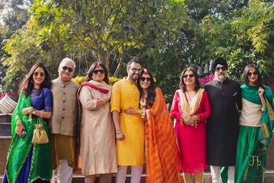 The bride and groom with their family at their haldi ceremony