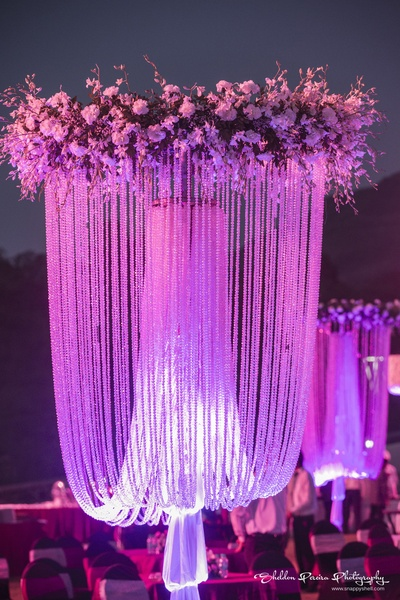 Carnation flowers and fern decoration with pearl strings