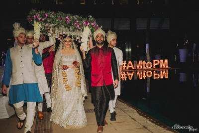 the bride entering under a phoolon ki chadar