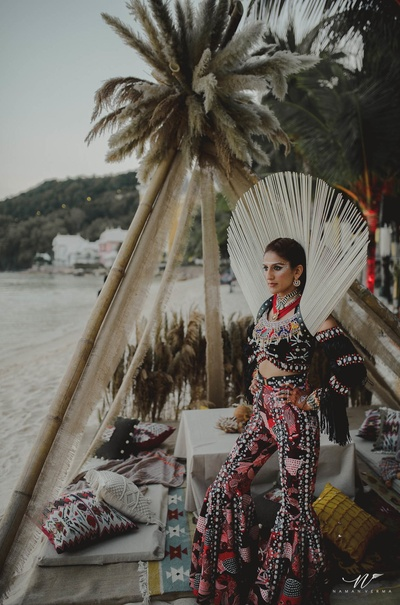 Kaabia dressed in a red and black outfit with seashells and tribal makeup for the henna sundowner