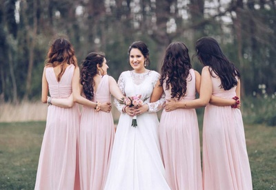 Bride and bridesmaid pose together for their pre wedding shoot