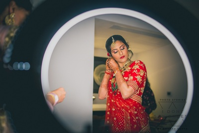 candid capture of the bride getting ready for her wedding