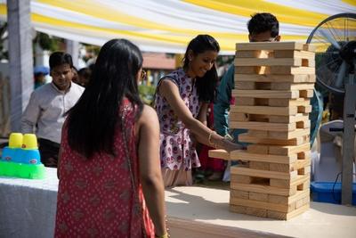 guests indulging enjoying the fun jenga games at shaili and mahesh's mehendi ceremoy