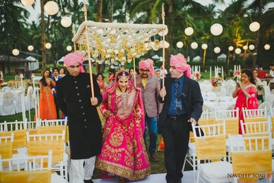 The bride entering in a beautiful phoolon ki chadaar