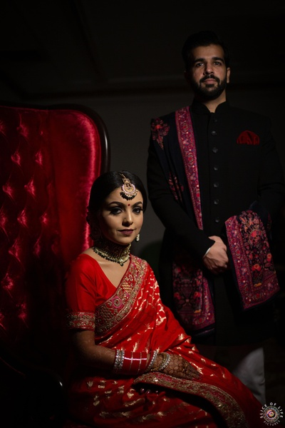 the couple posing at their reception