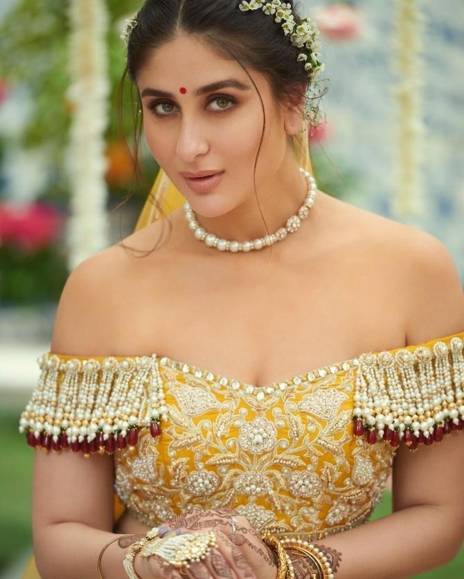3ddfed859 Kareena Kapoor stole all hearts in stunning off shoulder yellow and beige  with muted tones of red lehenga colour combination. This Abu Jani Sandeep  Khosla ...
