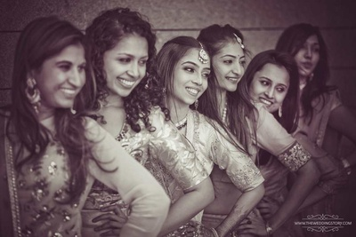 Black and white photo of the bride and her bridesmaids posing together