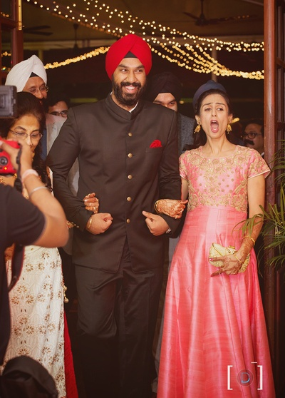 Groom Tejkaran enters royally holding his sister's and mother's hands for the Sangeet ceremony held at Jehanuma palace lawns, Bhopal.