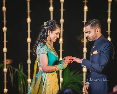 Ring exchange between the bride and groom during the engagement function