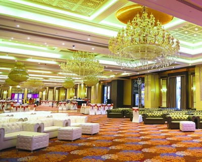 Indoor banquet hall lit up for the sangeet ceremony
