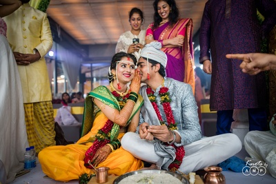 Candid wedding photography of the bride and groom as the wedding ceremony progresses