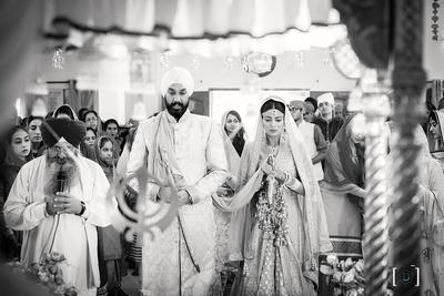 Black and white candid wedding photography by Dhanika Choksi.