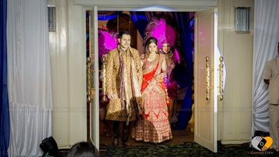 Gold brown embellished sherwani, churidar and a dual toned dupatta with mojris