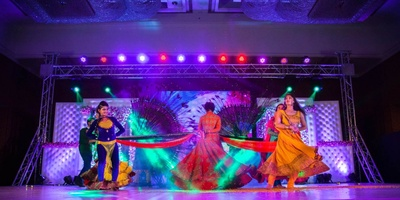 outdoor sangeet ceremony with a dance performance in colourful outfits.