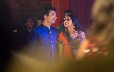 Dressed in coordinated complimenting outfits for the sangeet ceremony