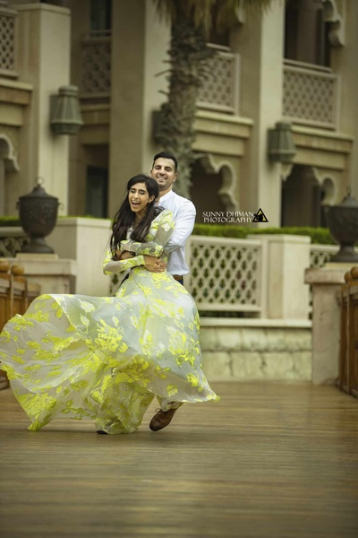 The bride and groom in a candid pose shot by Sunny Dhiman Photography
