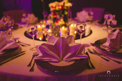 Table napkin folded in style with tinted table settings for the intimate reception ceremony