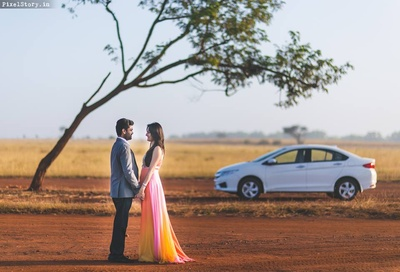 Khushboo wearing colorful ombre dyed full gown and Gaurav complementing her in a grey blazer.