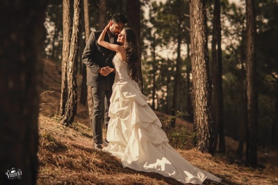 Candid couple pre wedding shoot in an off-white gown and black suit