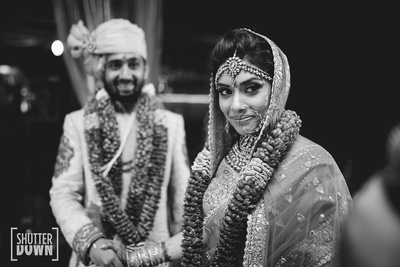 black and white picture of the couple during the ceremony