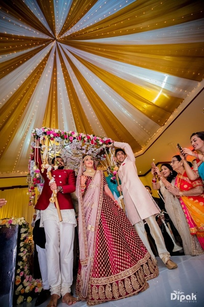 Bride entering the Wedding ceremony under the floral chadar