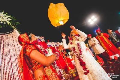 Romantic post wedding photo shoot ideas. Celebrating their new beginning with a lantern