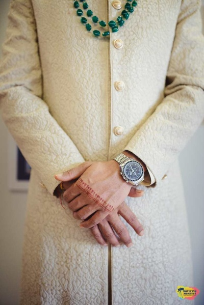 Close up picture of the groom's attire and accessories