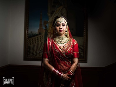 The bride poses for a candid shot in her entire wedding attire before the wedding starts