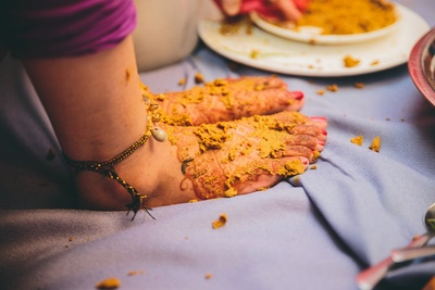 Feets filled with haldi paste .