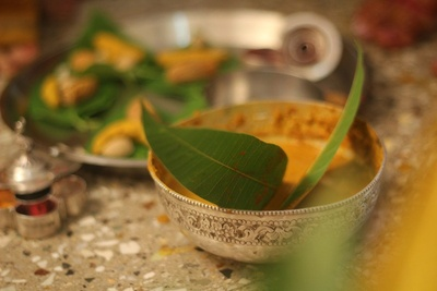 Haldi ceremony preparations in a an intricately designed silver bowl