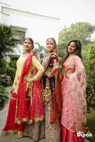 Bride and bridesmaids pose in matching colors for the wedding function