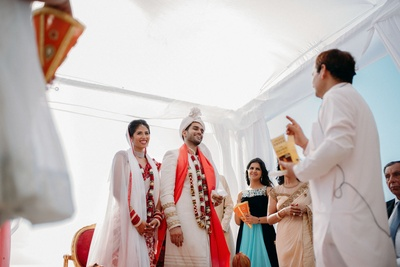 bride and groom captured in a candid shot post the wedding rituals