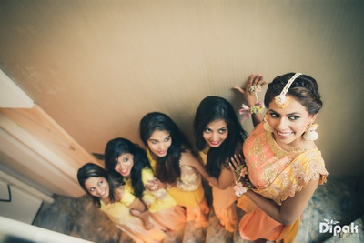 Bride and her bridesmaids pose for Dipak Studios during the mehndi function