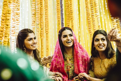 the bride is all smiles at her chudha ceremony