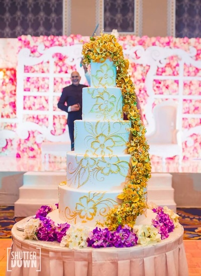 The grand white cake for the reception
