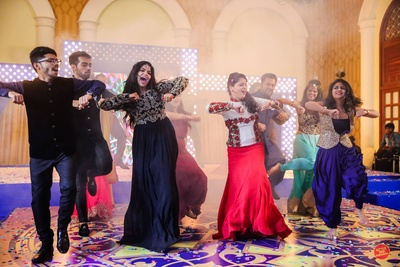 Friends and family performing at the sangeet ceremony.