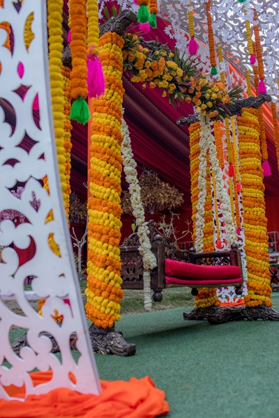 The mehendi ceremony saw a large swing wrapped in marigolds, decorated for the couple.