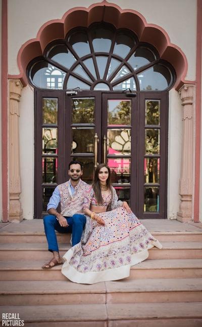 Bride and groom posing for their mehendi photo shoot