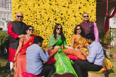 The bride posing with her family during the mehendi ceremony