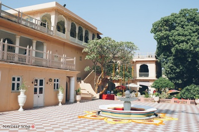 Chomu Palace lavishly decorated with Marigold flowers for the couple's nuptial ceremony