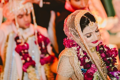 Cute expressions of the pretty bride during the happy wedding ceremony