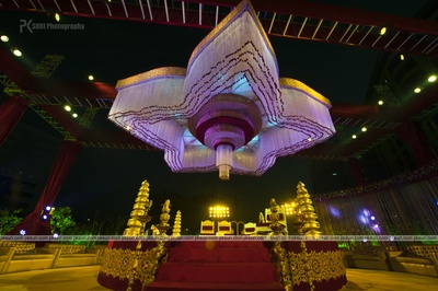 Grand open air mandap with dangling strings in a floral shape
