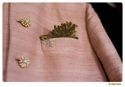 Blush raw silk wedding sherwani with 3d button details and a cut out pocket square